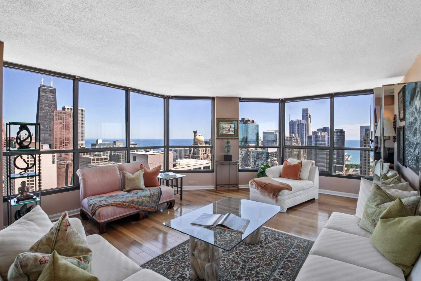 Real estate picture of a living room with amazing views in an apartment for sale