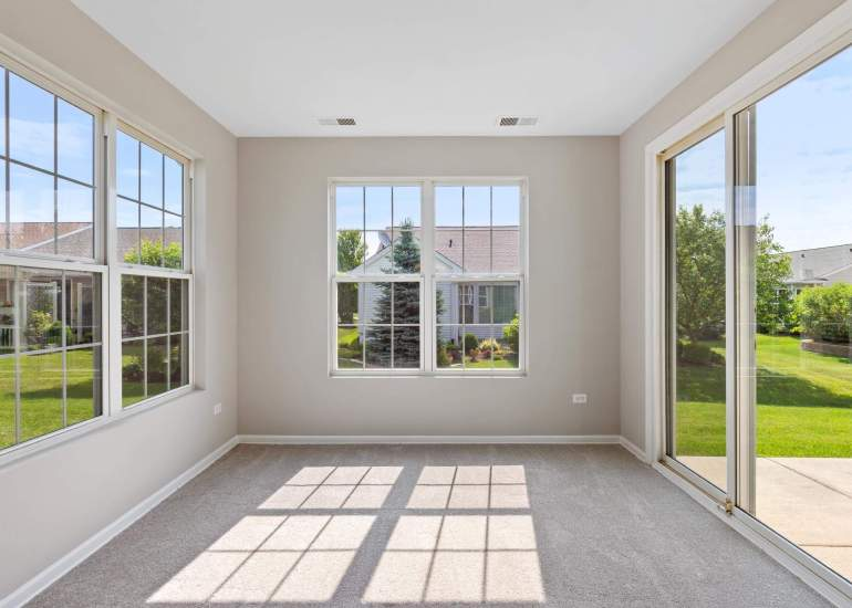 Virtual staging services for real estate photography - empty sunroom before digital staging