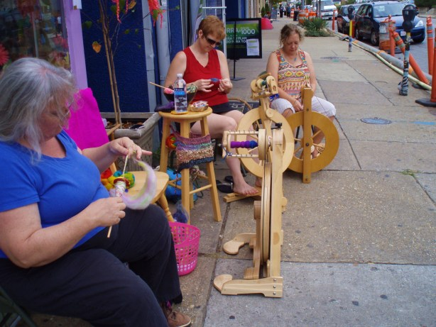 Rose, Corrine, and Kathy work on their spinning projects for the day.