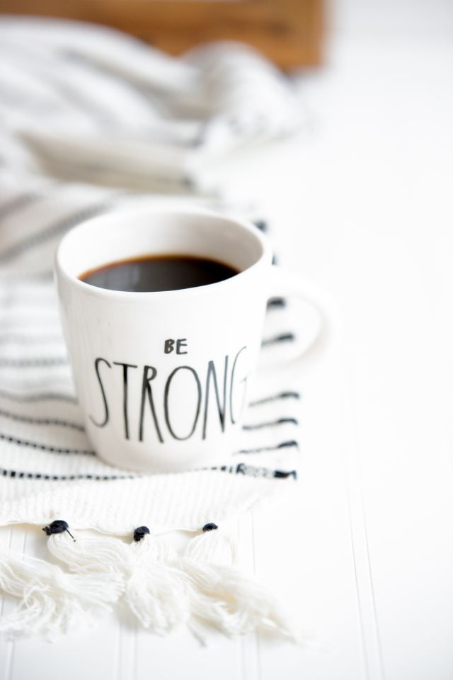 Coffee cup that says Be Strong