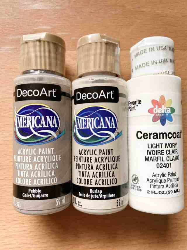 The paint I used to get a faux bleached wood finish on my dark stained upcycled candle holders.