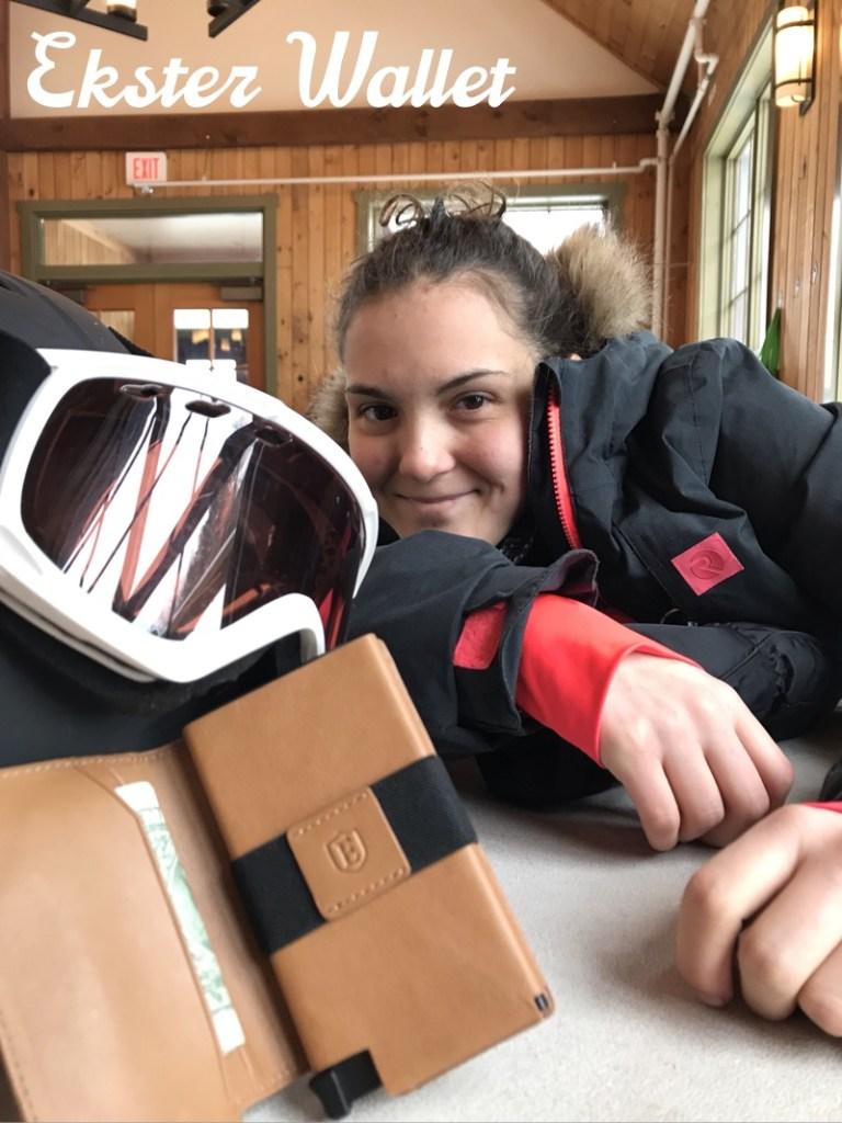 teen_in_ski_lodge_beside_ekster_wallet_and_ski_goggles