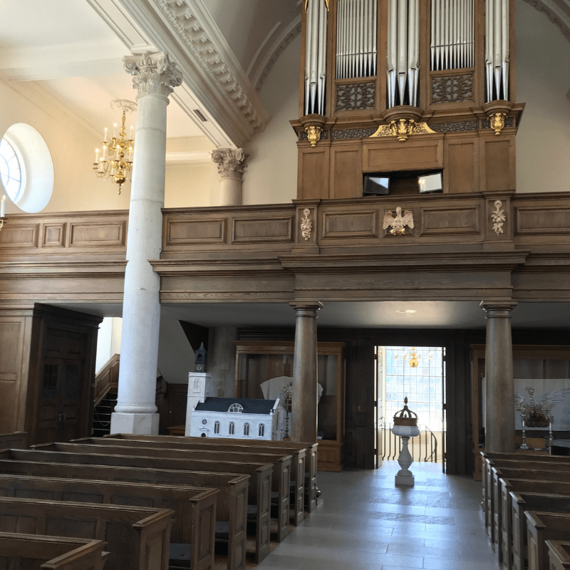 St. Mary the Virgin, Aldermanbury Church in Fulton Missouri. Inside the church showing ornate columns and rows of seats as well as the organ in balcony area