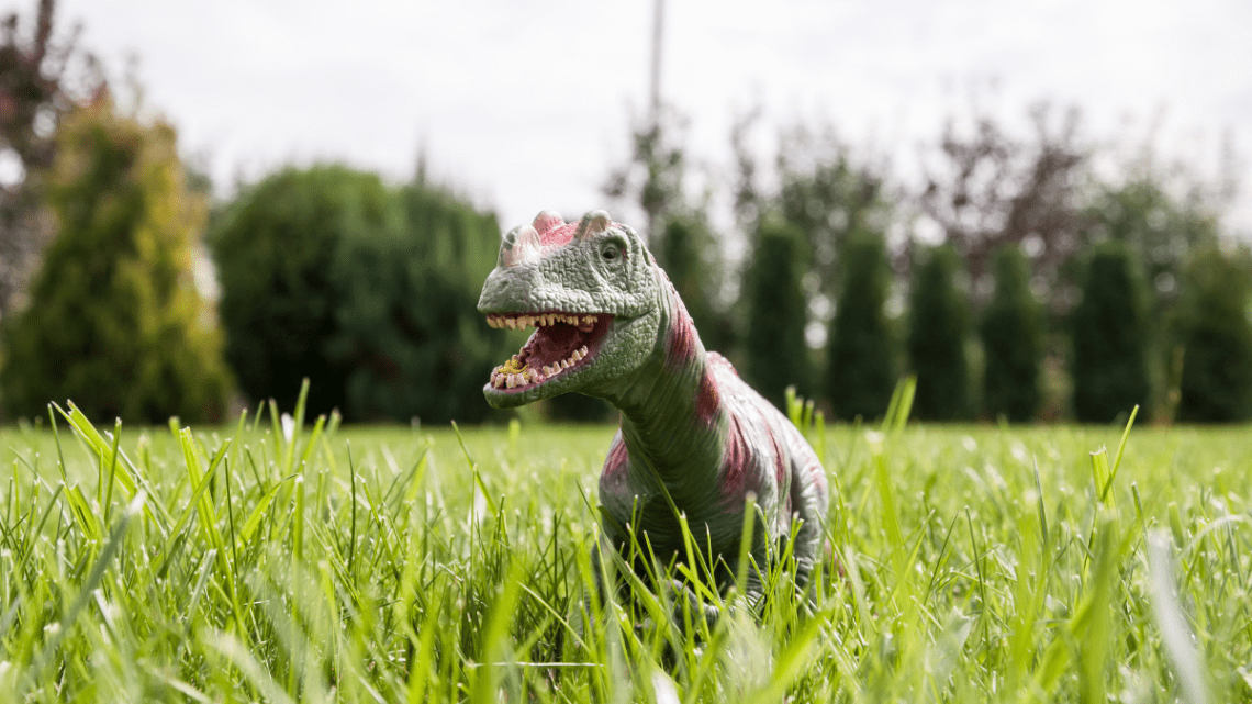 dinosaur_toys_in_grass