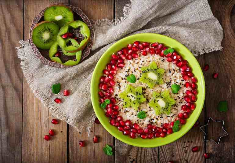 Tasty and healthy oatmeal porridge with fruit, berry and flax seeds healthy late night snacks.