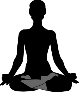 Silhouette of a person meditating.