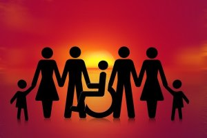 Disability inclusion black stick figures of men and women in front of sunset.