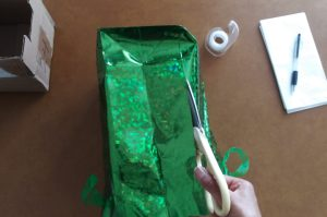 Cutting sides of gift bag.