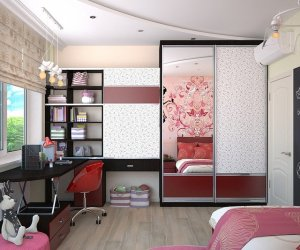 Little girl's pink and black room with shelves, desk and mirror.