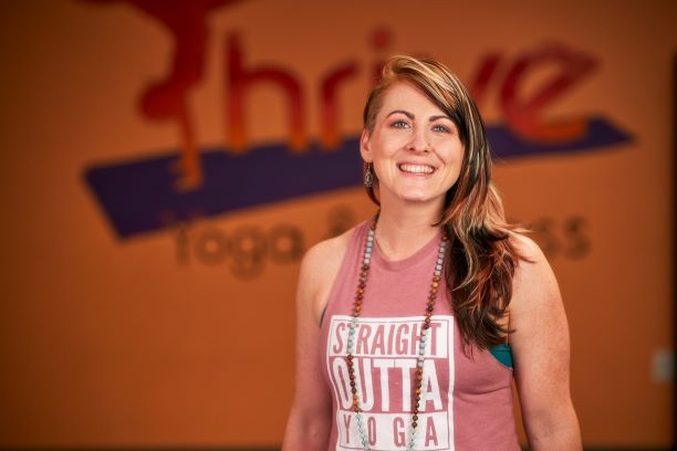 Erin Colleen Geraghty, RYT-500 and owner of Thrive Yoga & Fitness