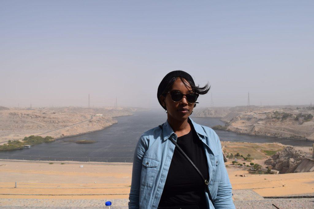 Female black travel blogger at the Aswan High Dam
