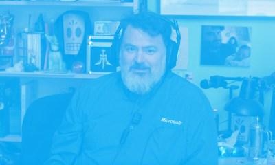 Tim Schafer Microsoft shirt listening to actual Zune