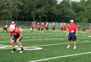 Defensive coordinator Bill Clark working with Jake Johnson and the linebackers during individual drills during preseason camp in 2012.