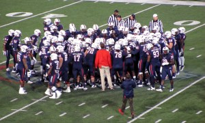 South Alabama gathers around Colton Sawyer at midfield prior to kickoff against Texas State.