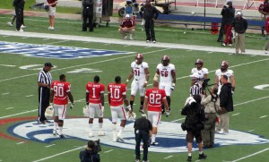 Game Captains for South Alabama Romelle Jones, B.J. Scott, Greg Hollinger and Alex Page meet the Troy captains at mid-field for the coin toss in the two teams first meeting and the Jaguars first Sun Belt Conference game.