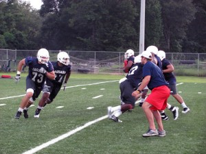 Shaun Artz (73) and Melvin Meggs (77) practice run blocking during the preseason camp in 2012. Artz will forgo his final year of eligibility due to health issues.