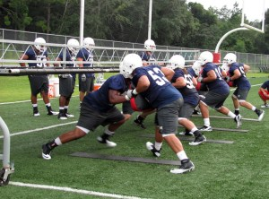 Offensive lineman running position drills in 2012 preseason camp.