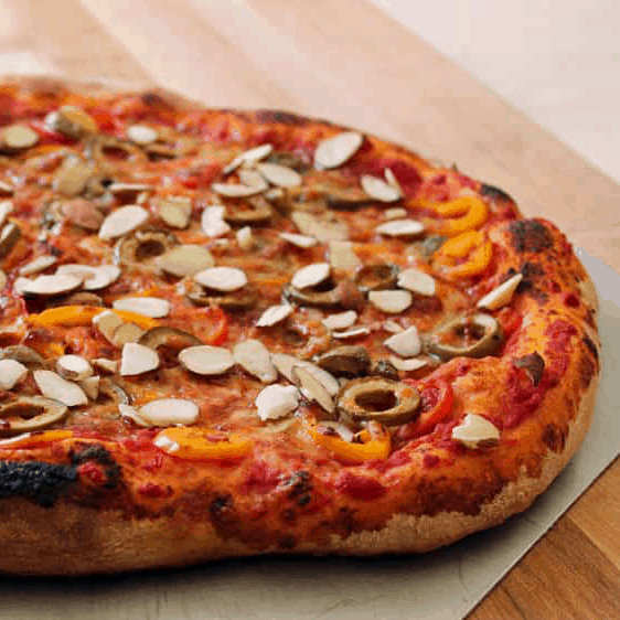 summer pizza recipe: pepper olive and manchego pizza