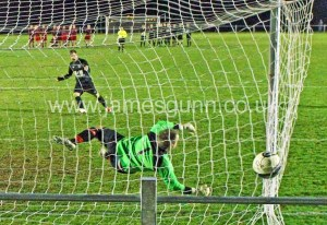 Michael Petrie scores the winning penalty in the Ness cup semi final at Morrison Park