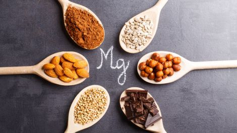 products rich in magnesium on wooden spoons.