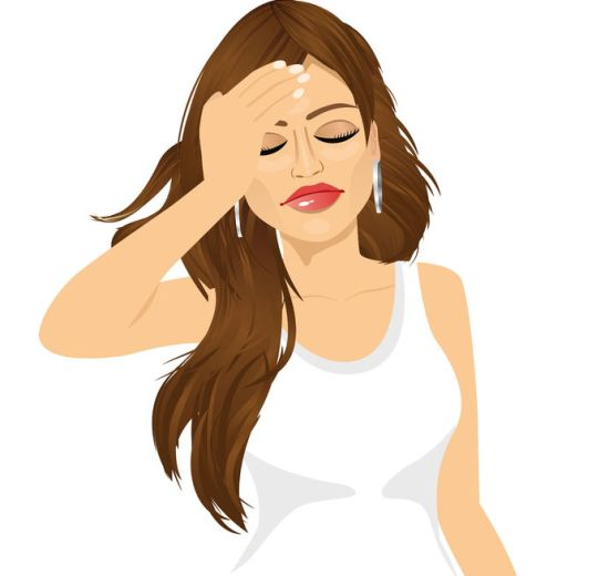 portrait of brunette woman touching her head suffering a painful headache isolated over white background