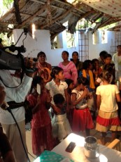 Filming at a mission school in India.