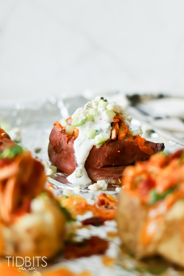 Pressure Cooker Buffalo Chicken Stuffed Potatoes - delicious on russet or sweet potatoes.