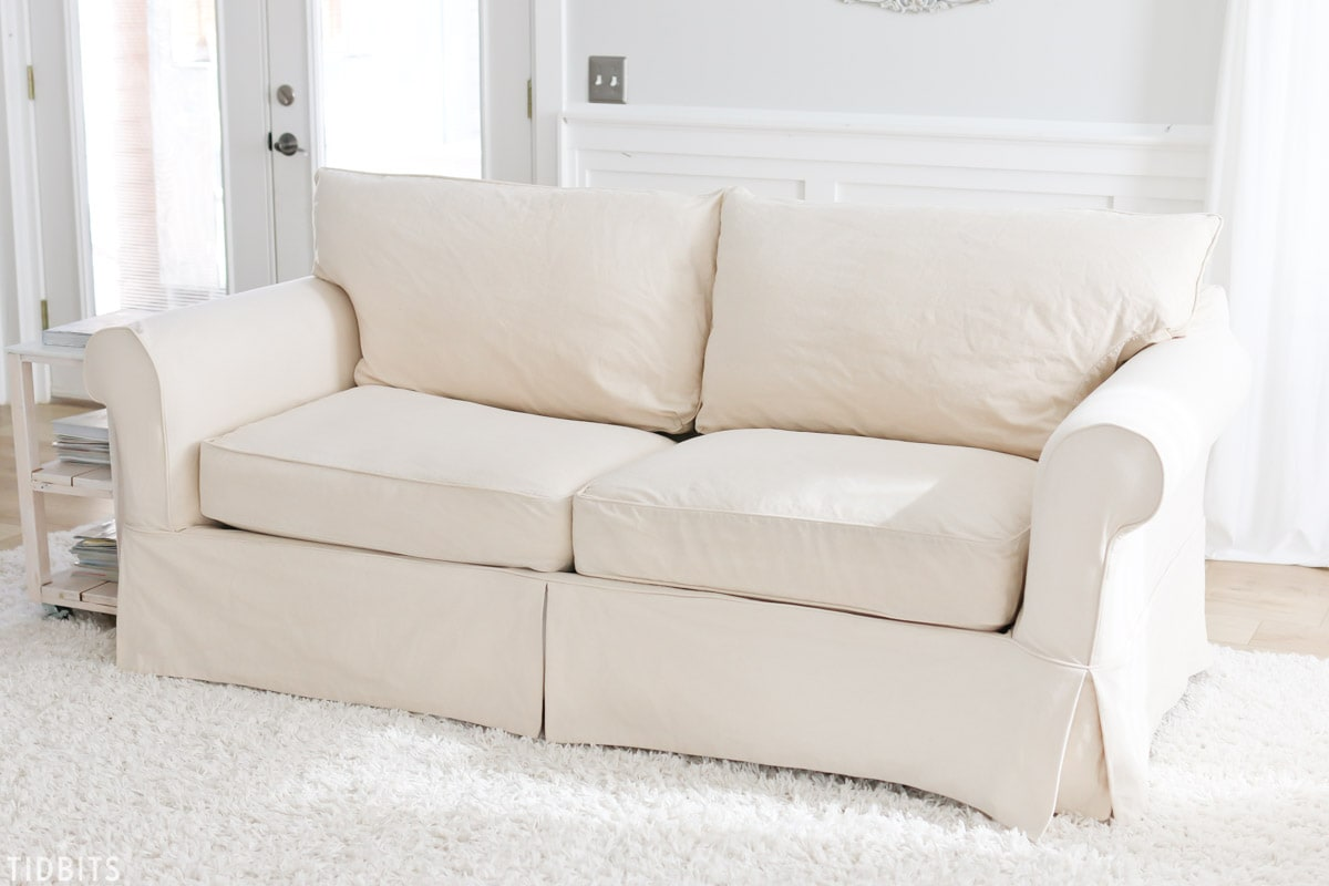 Tips and tricks for cleaning slipcovers naturally. 4 kids + white sofa . . . no problem!