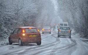 Picture of UK cars struggling to stay on the road in snowy weather