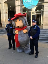 Orinoco with two policemen outside Wimbledon Centre Court shopping centre