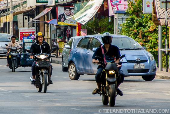 three thai motorbike drivers