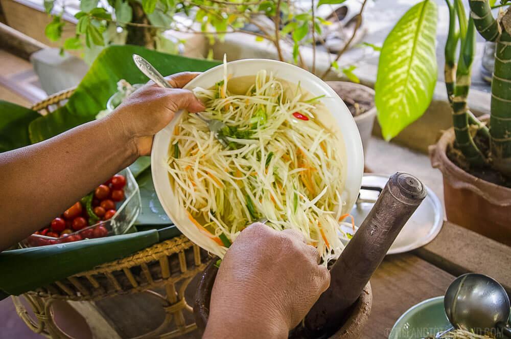 Freshly grated unripe papaya for som tum Thai