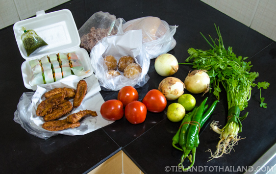 Fresh produce and snacks after grocery shopping in Thailand at a local market.