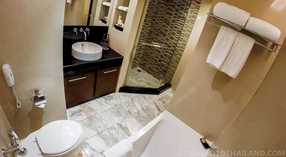 Rain shower, herbal shampoo, and soaking tub at The Sukosol
