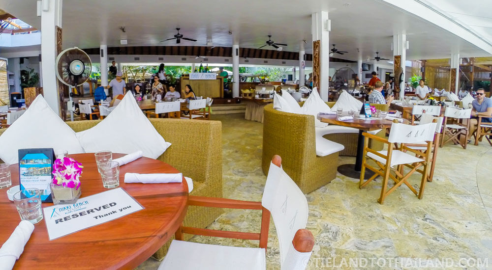 Outdoor shaded seating at Nikki Beach Koh Samui Sunday Brunch