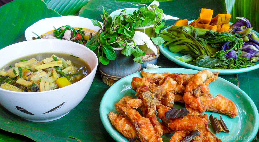 Fried river fish, sour soup and steamed vegetables