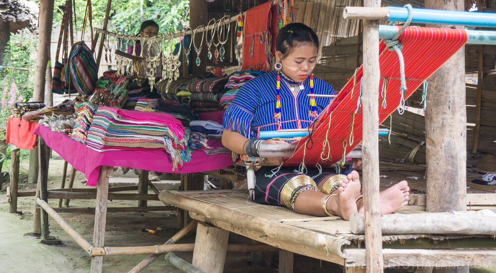 Girl weaving at the Long Neck Village in Chiang Mai