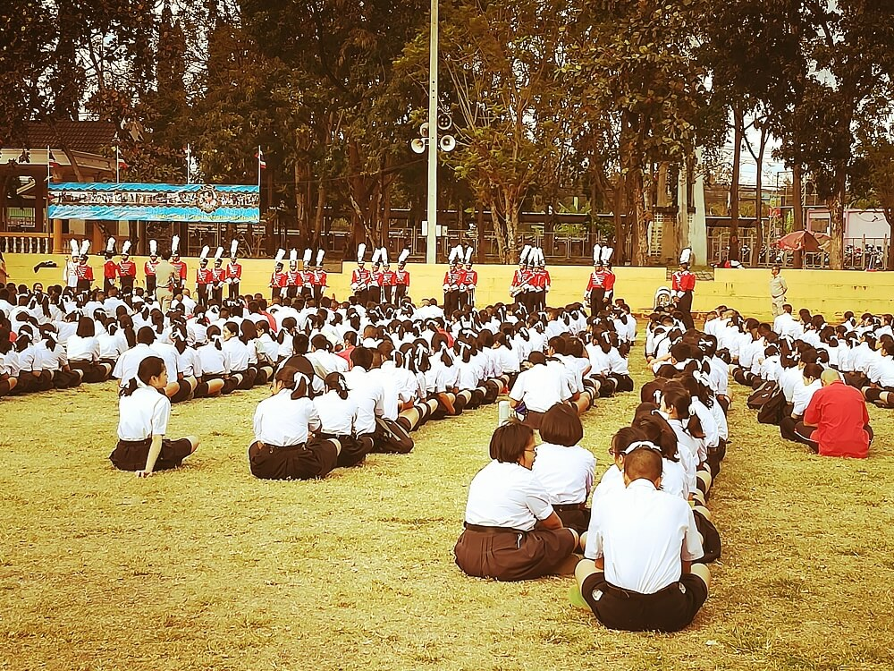 Students assembling on a field at a Sine Education school