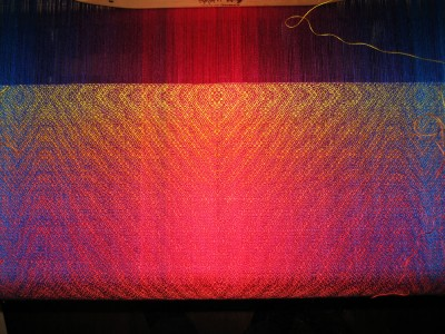 color play: turquoise to fuchsia in warp and red to gold in the weft