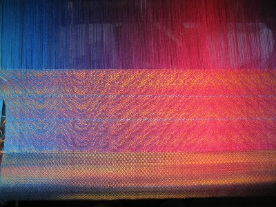 Knitted blank dyed in vertical stripes, unraveled and woven up
