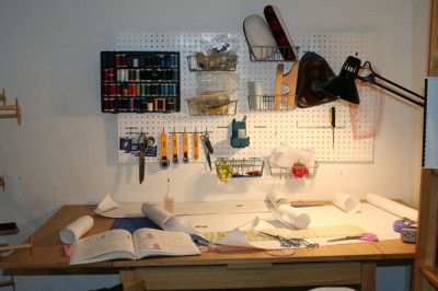 My sewing table, spread out with my first project, with the pegboard organizer in the background.