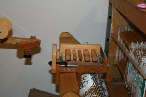 Tension box mounted on the back of the loom.