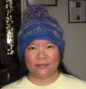 Funky knitted hat with pom-pom