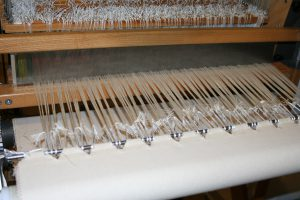 Warp, lashed on and ready to weave