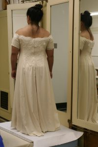 handwoven wedding dress, partially complete, back view