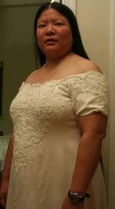 pearls basted onto handwoven wedding dress