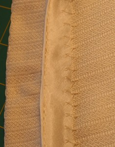 hem construction on handwoven wedding dress, nearly-finished