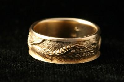 dragon phoenix ring, carved by Carol Mortensen