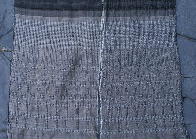 Waffle weave, networked and allover pattern, with white 60/2 silk weft, beaten firmly.  Warp is black 60/2 silk sett at 40 epi.