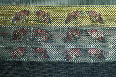 1st samples of handwoven butterfly patterns in taquete